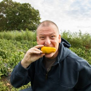 Chef Rich biting into a yellow pepper